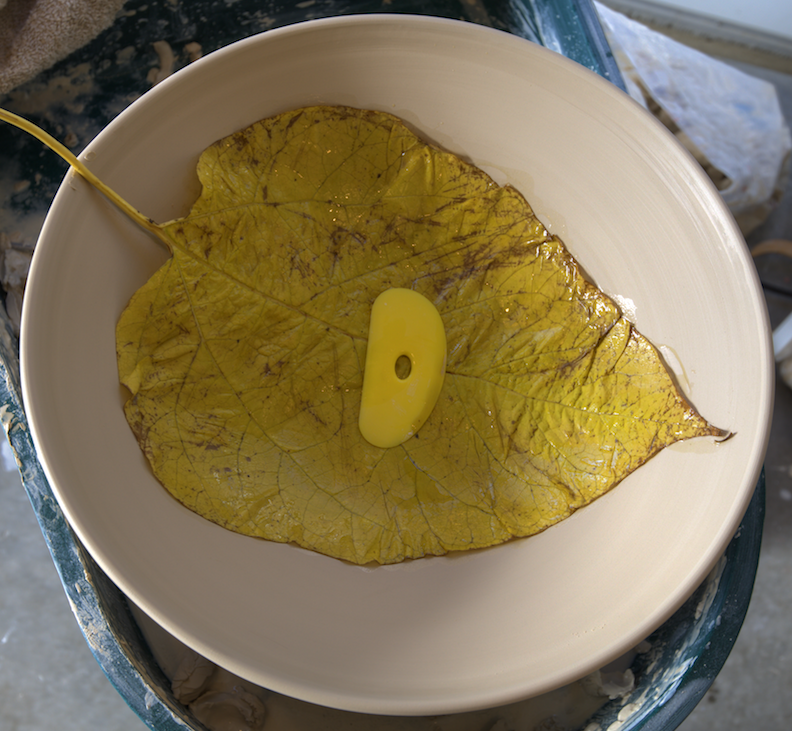 leaf pressed into bowl
